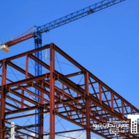 New building structure and crane over blue sky